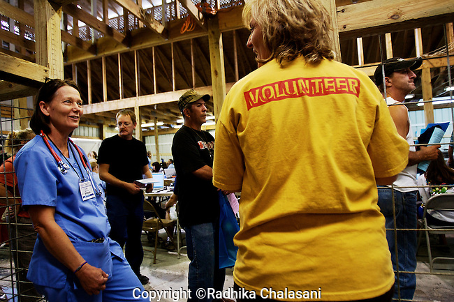 WISE, VIRGINIA-JULY 24: Nurse Betty George (left) from Harrisonburg, Virginia talks to a volunteer during the registration process for free medical care with The Remote Area Medical Expedition during a two and half day event at the Virginia-Kentucky July 24, 2009. RAM transformed farm buildings into a makeshift field hospital to treat 2,715 people.  Patients came from as far away as New York for treatment. Organizers estimate that they provided over $1.6 million USD worth of care.