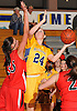Melanie Hingher #24 of Massapequa, right, looks to shoot over Rachel Mahler #35 of Syosset battle during a Nassau County Conference AA-I varsity girls' basketball game at Massapequa High School on Friday, Jan. 15, 2016. Hingher recorded 19 points and 10 boards in Massapequa's 60-33 win.