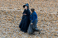 BNPS.co.uk (01202 558833)<br /> Pic: Graham Hunt/BNPS<br /> <br /> Kate Winslet and Saoirse Ronan filming a scene on the Beach at Eype near Bridport in Dorset yesterday for the controversial new film Ammonite about the life of fossil hunter Mary Anning.