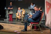 Veranstaltung der Reihe GehtAuchAnders mit einer Diskussion zur Berliner Abgeordnetenhauswahl 2016 im Heimathafen Neukoelln.<br /> Die Initiative hatte sechs Kandidaten der wahrscheinlich in der kommenden Legislaturperiode im Abgeordnetenhaus vertretenen Parteien zu einer Diskussion eingeladen. Die Kandidaten mussten sich in einer ersten Runde anonym Fragen von stadtpolitischen Gruppen stellen. Im Anschluss gab es eine Podiumsdiskussion zu stadtpolitischen Themen, bei der die Kandidaten fuer das Publikum sichtbar waren.<br /> Als Diskutanten nahmen teil: Dr. Matthias Kollatz-Ahnen, (SPD) Finanzsenator; Christian Goiny, MdA (CDU), medienpolitischer Sprecher Katrin Lompscher; MdA (Linkspartei), stellv. Fraktionsvorsitzende und Sprecherin fuer Stadtentwicklung, Bauen und Wohnen; Antje Kapek, MdA (Buendnis 90/Die Gruenen), Fraktionsvorsitzende und Spitzenkandidatin;  Bernd Schloemer (FDP), Spitzenkandidat Friedrichshain-Kreuzberg und ehem. Vorsitzender Piratenpartei; Karsten Woldeit (AfD), Platz 2 der Landesliste und Direktkandidat in Lichtenberg. Moderiert wurde die Veranstaltung von P.R. Kantate (Musiker) und Jakob Preuss (Filmemacher).<br /> Die Veranstaltung wurde von lautstarken Protesten ausserhalb und innerhalb des Veranstaltungssaal begleitet. Zwischen Anhaengern der rassistischen AfD und AfD-Gegnern kam es zu Poebeleien und Beleidigungen. Ordner verwiesen mehrere Personen aus dem Veranstaltungssaal.<br /> Die Veranstalter von GehtAuchAnders, Kuenstler aus Berlin, veranstalten in unregelmaessigen Abstaenden Diskussionsabende zu politischen Themen.<br /> Rechts im Bild: Karsten Woldeit, AfD-Kandidat und Wahlkampfleiter der Partei in Berlin.<br /> 13.9.2016, Berlin<br /> Copyright: Christian-Ditsch.de<br /> [Inhaltsveraendernde Manipulation des Fotos nur nach ausdruecklicher Genehmigung des Fotografen. Vereinbarungen ueber Abtretung von Persoenlichkeitsrechten/Model Release der abgebildeten Person/Personen liegen nicht vor. NO MODEL RELEASE! Nur fuer Redaktionelle