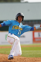 Myrtle Beach Pelicans shortstop Aramis Ademan (11) running the bases during the first game of a doubleheader against the Frederick Keys at Ticketreturn Field at Pelicans Ballpark on April 8, 2018 in Myrtle Beach, South Carolina. Frederick defeated Myrtle Beach 6-4. (Robert Gurganus/Four Seam Images)