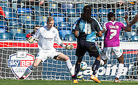 Andy Yiadom of Barnet scores his goal past Goalkeeper Ryan Allsop (Loanee from Bournemouth) of Wycombe Wanderers during the Sky Bet League 2 match between Wycombe Wanderers and Barnet at Adams Park, High Wycombe, England on 16 April 2016. Photo by Andy Rowland.