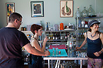 Stone Barn Brandyworks, a micro-distillery in SE Portland, Oregon run by Sebastian and Erica Degens.  They make products that include rye whiskey, pear brandy, and other varieties of distilled spirits and operate out of a very small, green warehouse space.  Their products are not yet for sale other than directly from them.  Erica Degens offering up a Saturday afternoon tasting in their warehouse.