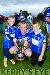 St Brendans captain Denis Moriarty with his sons Jamie and Jack after they defeated Kilgarvan in the County Intermediate Hurling Championship final in killarney on Saturday