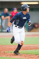 Dante Bichette Jr. #49 of Team Blue hustles down the first base line against Team Red during the USA Baseball 18U National Team Trials at the USA Baseball National Training Center on June 30, 2010, in Cary, North Carolina.  Photo by Brian Westerholt / Four Seam Images