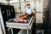 Durham, North Carolina - Thursday March 24, 2016 - Barbeque Man, and co-owner of PICNIC, Wyatt Dickson, wheels a freshly smoked pig from the custom-made smokers into the kitchen of the BBQ restaurant in Durham.