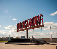 "The rotating ""Understanding"" public art sculpture in Brooklyn Bridge Park in New York on Sunday, October 23, 2016. ""Understanding"" by the artist Martin Creed features a 25 foot tall rotating red sculpture spelling out the word understanding reminiscent of a billboard on the side of a highway.  (© Richard B. Levine)"