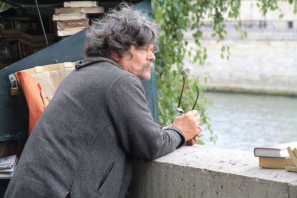 Man selling artwork and books along the Seine River, Paris, France. .  John offers private photo tours in Denver, Boulder and throughout Colorado, USA.  Year-round. .  John offers private photo tours in Denver, Boulder and throughout Colorado. Year-round.