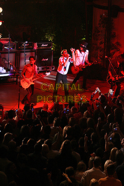 DAVE NAVARRO, SCOTT WEILAND & SLASH.Camp Freddy & The Panic Channel Perform at The Palms Pool Opening Party hosted by 944 Magazine held at The Palms Casino Resort, Las Vegas, Nevada, USA,.1 July 2006..full length guitar concert open-air gig music band live on stage crowd audience.Ref: ADM/ZL.www.capitalpictures.com.sales@capitalpictures.com.©Zach Lipp/AdMedia/Capital Pictures.