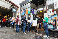 """Pictured: Fans queue outside Spillers Records.  Friday 13 September 2019<br /> Re: American Band Pixies have signed copies of their latest album """"Beneath The Eyrie"""" at Spillers Records, the oldest record shop in the world, in Morgan Arcade, Cardiff, Wales, UK."""