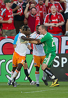01 July 2010:  Toronto FC goalkeeper Stefan Frei #24 tries to calm down Houston Dynamo forward Joseph Ngwenya #33 during a game between the Houston Dynamo and the Toronto FC at BMO Field in Toronto..Final score was 1-1....