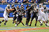 20 December 2011:  FIU running back Darriet Perry (28) carries the ball in the second quarter as the Marshall University Thundering Herd defeated the FIU Golden Panthers, 20-10, to win the Beef 'O'Brady's St. Petersburg Bowl at Tropicana Field in St. Petersburg, Florida.