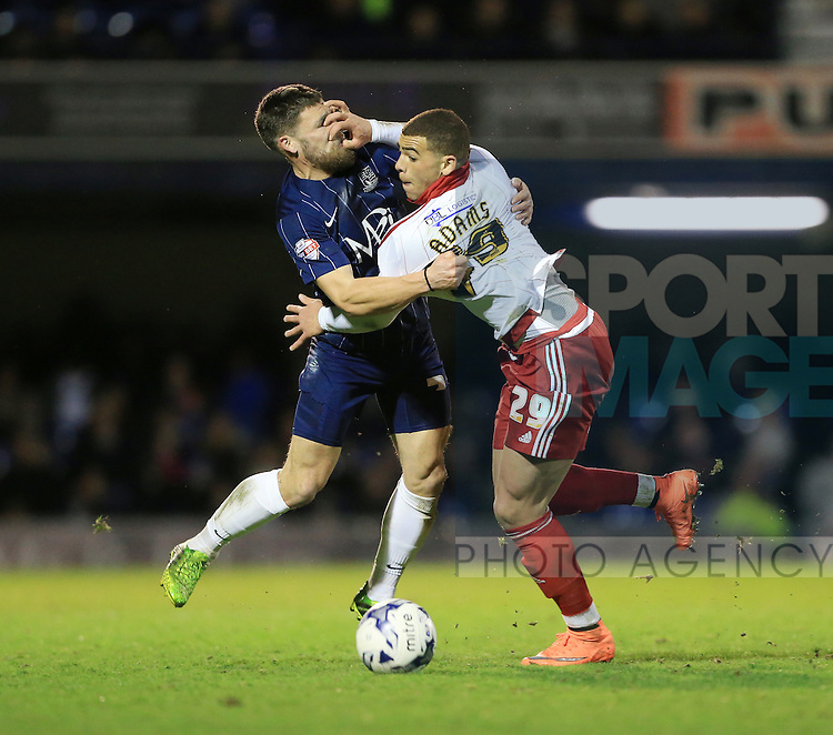 Southend's Gary Deegan tussles with Sheffield United's Che Adams during the League One match at Roots Hall Stadium.  Photo credit should read: David Klein/Sportimage