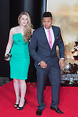 "Actor Franz Drameh with guest. First World Premiere of the new Tom Cruise and Emily Blunt movie ""Edge of Tomorrow"" at the BFI IMAX cinema in London, United Kingdom. As the film is about reliving the events of one day over and over in an epic battle to save the world, the stars of ""Edge of Tomorrow"" take part in a worldwide event when, for the first time ever, three fan premieres will be held in three different countries in just one day."