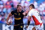 Max Calitz of Germany (L) rin action against Jose Coyickal Seru of Japan (R) the ball during the HSBC World Rugby Sevens Series Qualifier Final match between Germany and Japan as part of the HSBC Hong Kong Sevens 2018 on 08 April 2018 in Hong Kong, Hong Kong. Photo by Marcio Rodrigo Machado / Power Sport Images