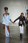 Designer Rorisang Ratsui walks runway with model at the close of her Rorisang Ratsui collection for Free Fashion Week at Cope NYC, on October 11, 2019, during Fashion Week Brooklyn Spring Summer 2020.