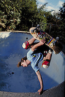 EXTREME SKATEBOARDER IN EMPTY SWIMMING POOL. SKATEBOARDER. SAN FRANCISCO CALIFORNIA USA.