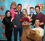 """Veronica J. Kuehn, Jason Jacoby and Matt Dengler with Avenue Q & Puppetry Fans during """"Avenue Q"""" Celebrates World Puppetry Day at The New World Stages on 3/21/2019 in New York City."""