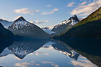 Bard Peak and Burns glacier, reflection in Portage lake, Portage, Alaska.