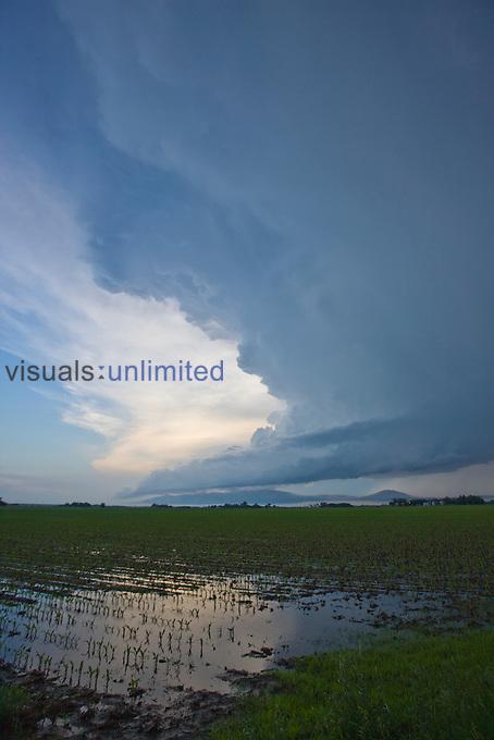 A supercell in western Nebraska reflected in flooded fields, USA.