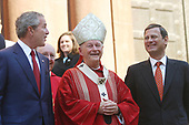 2 October 2005 – Washington, DC – President George W. Bush attends 52nd Annual Red Mass at St. Matthews Cathedral.  Red Mass is a tradition that is held the Sunday prior to the Supreme Court's opening session.  The service gives special prayers for the court and the judges as they start hearing this session's cases.   This mass is special in that the new Chief Justice John Roberts was in attendance along with his wife Jane.  First lady Laura Bush was in attendance as well as Secretary of State Condoleezza Rice and White House Chief of Staff Andrew Card.  Cardinal Theodore McCarrick, Archbishop of Washington, presides over mass and then walked out of the church at the end of the ceremony and stood on the steps next to President Bush and Chief Justice John Roberts.<br /> <br /> Photo Credit:  G. Fabiano/Sipa Press
