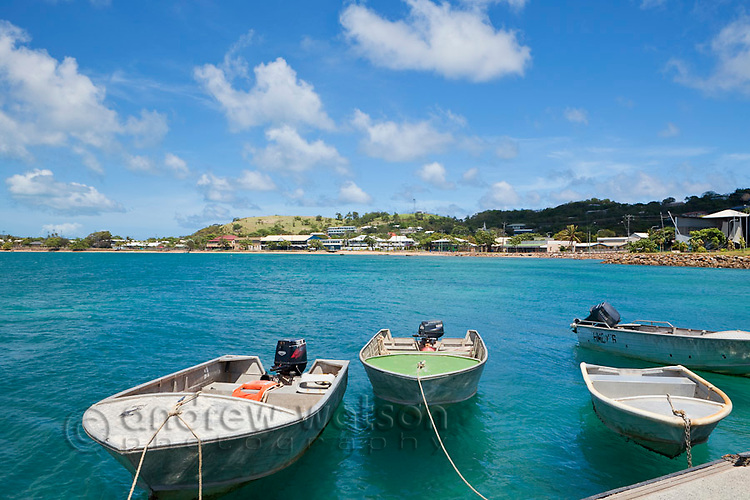 Dinghys moored at Engineers Wharf with Thursday Island township in the background.  Thursday Island, Torres Strait Islands, Queensland, Australia