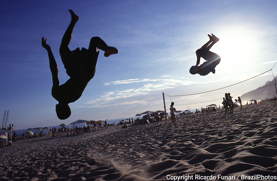 Children jump, play, give somersault and have fun at Ipanema beach, Rio de Janeiro, Brazil.