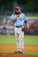 Tennessee Smokies pitcher P.J. Francescon (20) signals for two more warmup pitches during a game against the Montgomery Biscuits on May 25, 2015 at Riverwalk Stadium in Montgomery, Alabama.  Tennessee defeated Montgomery 6-3 as the game was called after eight innings due to rain.  (Mike Janes/Four Seam Images)