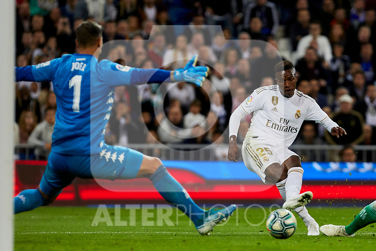 Vinicius Junior of Real Madrid and Joel Robles (L) and Sidnei Rechel da Silva (R) of Real Betis Balompie during La Liga match between Real Madrid and Real Betis Balompie at Santiago Bernabeu Stadium in Madrid, Spain. November 02, 2019. (ALTERPHOTOS/A. Perez Meca)