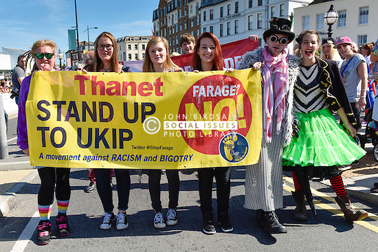 Young people carrying an anti-UKIP banner participate in the Kent Pride march in the seaside town of Margate to celebrate Kent Pride.