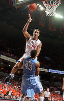 Virginia guard Malcolm Brogdon (15) shoots over James Michael McAdoo during the second half of an NCAA basketball game Monday Jan. 20, 2014 in Charlottesville, VA. Virginia defeated North Carolina 76-61. (Photo/Andrew Shurtleff)