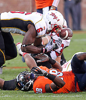 Nov 13, 2010; Charlottesville, VA, USA;  Maryland Terrapins defensive back Kenny Tate (6) almost comes up with a loose ball from Virginia Cavaliers wide receiver Kris Burd (18) during the 1st half of the game at Scott Stadium.  Mandatory Credit: Andrew Shurtleff