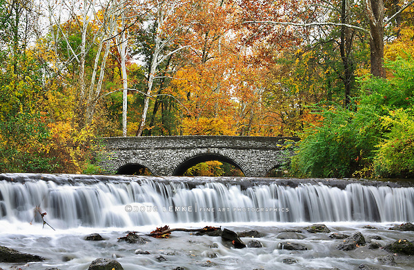 A Stone Bridge And Waterfall During Autumn In The Park, Sharon Woods, Southwestern Ohio, USA