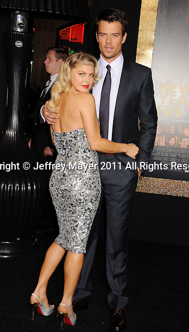 "HOLLYWOOD, CA - DECEMBER 05: Stacy Ann Ferguson aka Fergie and Josh Duhamel arrive at the Los Angeles premiere of ""New Year's Eve"" at Grauman's Chinese Theatre on December 5, 2011 in Hollywood, California."