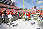 22 September 2007: NC State player captains Marcus Stone (9), Martrel Brown (41) and John Dunlap (1), followed by head coach Tom O'Brien (in white) lead the team onto the field. The Clemson University Tigers defeated the North Carolina State University Wolfpack 42-20 at Carter-Finley Stadium in Raleigh, North Carolina in an Atlantic Coast Conference NCAA College Football Division I game.