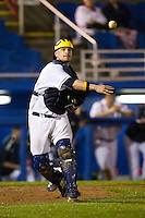 Michigan Wolverines catcher Coley Crank #3 throws to first during a game against the Pittsburgh Panthers at the Big Ten/Big East Challenge at Florida Auto Exchange Stadium on February 18, 2012 in Dunedin, Florida.  (Mike Janes/Four Seam Images)