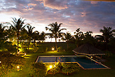 FRENCH POLYNESIA, Raiatea Island. A view of the swimming pool at dusk at the Raiatea Lodge.