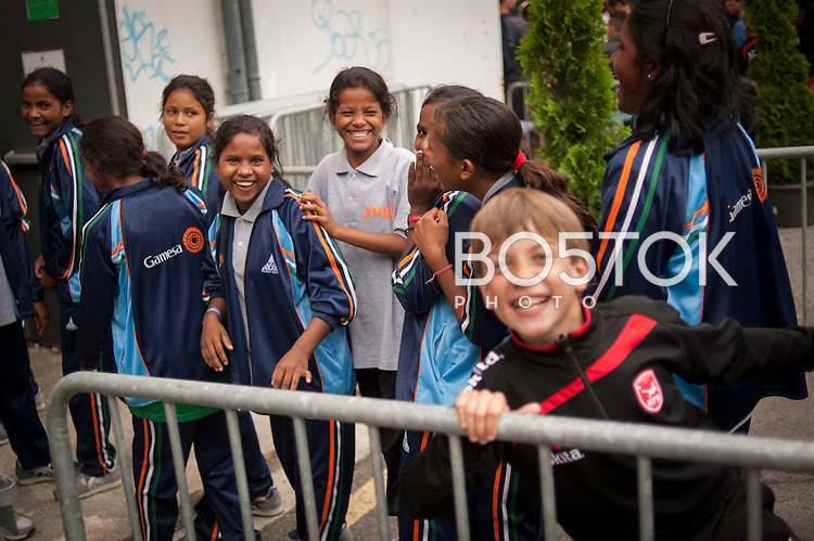 Yuwa team players converse with some other team players. Donostia-San Sebastian (Basque Country) 02 July 2013. Yuwa Jharkhand is a program for girls aged 5-17 to promote health, education and improved livelihoods through football. Yuwa team was in Donostia playing Donosti Cup international football tournament (Gari Garaialde/Bostok Photo)