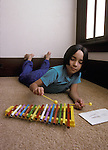 Berkeley CA Girl, 1/2 Latina, 8-yrs-old, learning to play little xylophone by following a number chart  MR