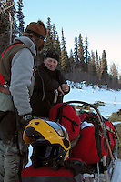 Ed Iten talks with Paul Gebhardt at Eagle Island. Gebhardt uses a snowmachine helmet to protect his face. Photo by Jon Little.
