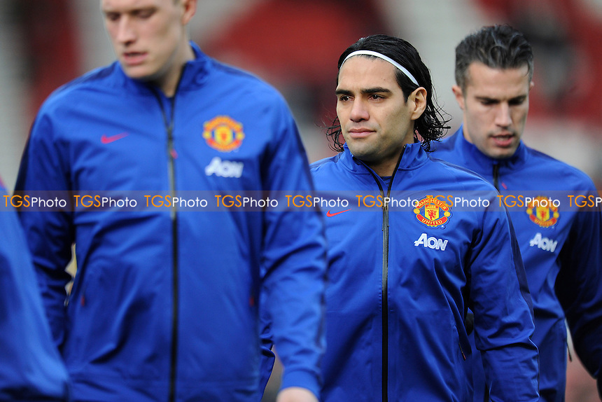 Radamel Falcao Garcia (center) of Manchester United warms up ahead of the match - Stoke City vs Manchester United - Barclays Premier League Football at the Britannia Stadium, Stoke-on-Trent - 01/01/15 - MANDATORY CREDIT: Greig Bertram/TGSPHOTO - Self billing applies where appropriate - contact@tgsphoto.co.uk - NO UNPAID USE