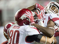 NWA Democrat-Gazette/JASON IVESTER <br /> Arkansas wide receiver Dominique Reed (87) (right) is pushed into the end zone for a touchdown during the fourth quarter against Alabama on Saturday, Oct. 10, 2015, at Bryant-Denny Stadium in Tuscaloosa, Ala.
