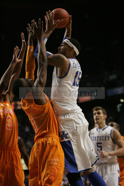 Freshman Forward Willie Cauley-Stein (15) drives to the basket against two Tennessee defenders during the University of Kentucky vs Tennessee Men's Basketball game in Lexington, Ky., on, January 15, 2013. Photo by Jared Glover | Staff