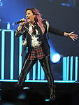 Demi Lovato performs live during her Neon Lights Tour ,this show was held at The Honda Center in Anaheim, California on February 13,2014                                                                               © 2014 RockinExposures