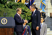 United States President George H.W. Bush, right, shakes hands with President Václav Havel of Czechoslovakia, left, as he hosts a State Arrival ceremony on the South Lawn of the White House on October 22, 1991.  Havel is visiting Washington for a State Visit.<br /> Credit: Ron Sachs / CNP