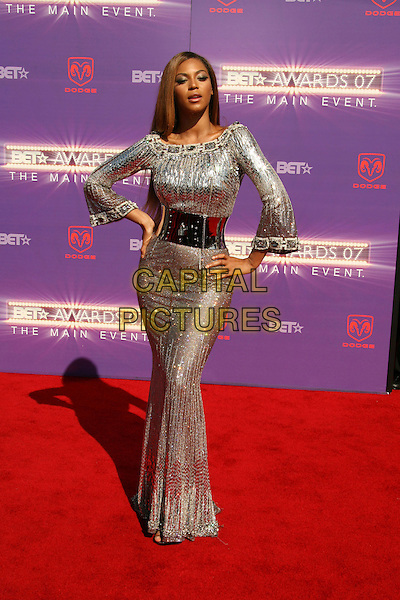 BEYONCE KNOWLES.2007 BET Awards held the at Shrine Auditorium, Los Angeles, California, USA..June 26th, 2007.full length silver grey gray sequins sequined shiny dress wide metallic belt hands on hips jewel encrusted .CAP/ADM/RE.©Russ Elliot/AdMedia/Capital Pictures