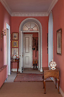 Many of the doorways in the house mirror the shape of the elegant fanlight windows and are decorated with delicate plasterwork moulding