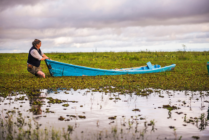 Maneuvering a boat in at Estancia San Juan de Poriahu, Ibera Wetlands, a marshland in Corrientes Province, Argentina