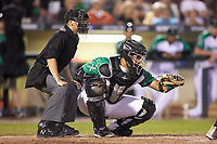 Dayton Dragons catcher Hendrik Clementina (24) frames a pitch as home plate umpire Harrison Silverman looks on during the game against the Bowling Green Hot Rods at Fifth Third Field on June 8, 2018 in Dayton, Ohio. The Hot Rods defeated the Dragons 11-4.  (Brian Westerholt/Four Seam Images)