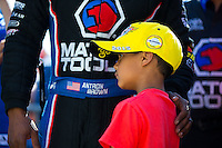 Jun 7, 2015; Englishtown, NJ, USA; NHRA top fuel driver Antron Brown celebrates with son Adler Brown after winning the Summernationals at Old Bridge Township Raceway Park. Mandatory Credit: Mark J. Rebilas-